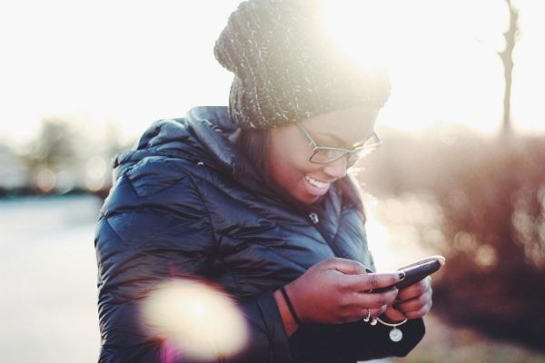 smiling women using phone